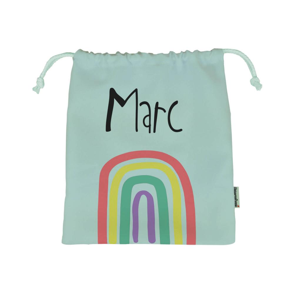 bolsa arco iris sobre fondo rosa